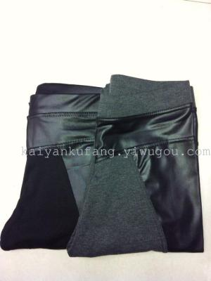 2014 hot Korean version more in autumn and winter plus velvet girl to spell leather leggings pencil pants ninth pants