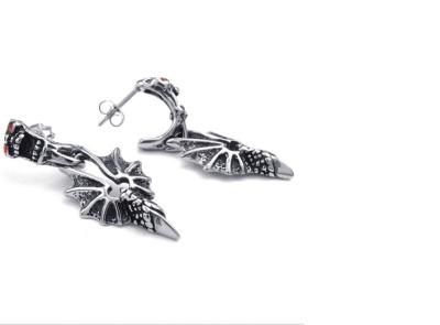 Stainless steel skull earrings. Pterosaur wings titanium earrings the coolest men in Europe
