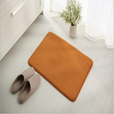 Short plush spongy cushion for cushioning bath mat.