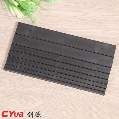 Black binder clip with 10 teeth edge strip.