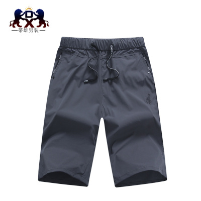 The summer male sports shorts in summer five loose beach pants breeches