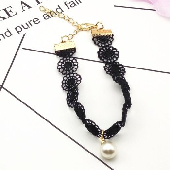 Korean version of the hand chain jewelry jewelry hollow retro lace rounded pearl pendant temperament bracelet female