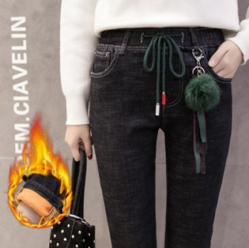 High-waisted black and velvet jeans and women's winter autumn stretch with cotton and thick warm pants