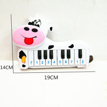 Children's puzzle toy bag children plastic cow 10 key electronic piano toys