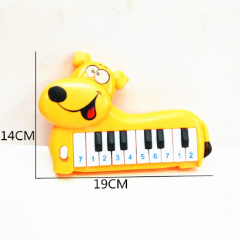 Children's new electronic toy bag for children's toy plastic cartoon dog 10 keys electronic piano toys