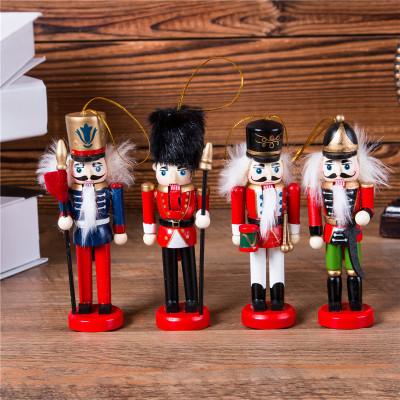 The new 12CM nutcracker puppet soldier presents a four-piece Christmas tree pendant.