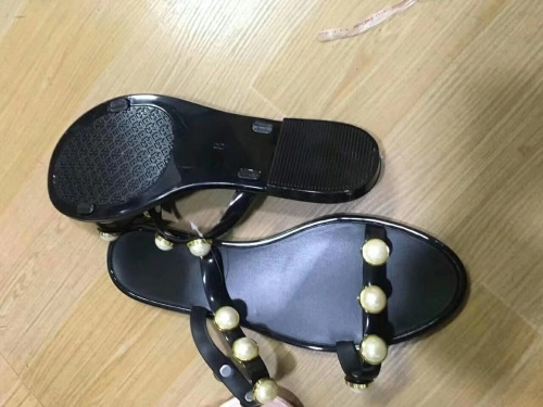 STOCK of slippers and sandals for women's shoes.