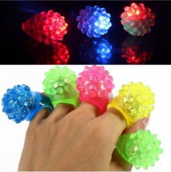 Strawberry fluorescence ring glitter strawberry silicone soft glue ring finger lamp.