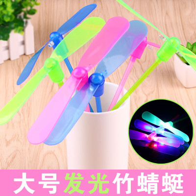 The bamboo dragonfly flying saucer toy luminous hand rubbing wholesale stalls selling