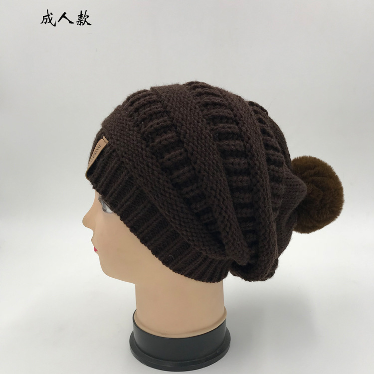 Qiu dong new long hair ball knitted hat men and women  s letter mark wool b76bd035279e
