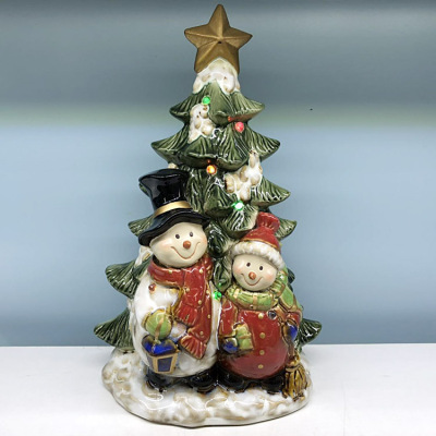 Christmas presents from Santa Claus snowman Christmas tree decorations pottery and crafts decorations with towns