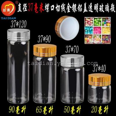 Gold silver cover transparent glass bottle wholesale sea cucumber bottle hand candy bottle.