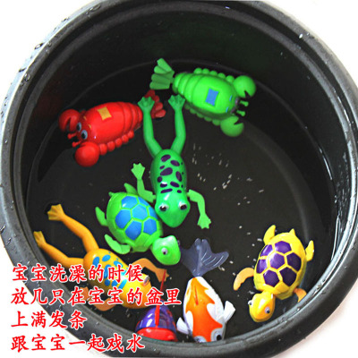 On the chain clockwork swimming animal toys baby clockbath water toys shuangwei work toys