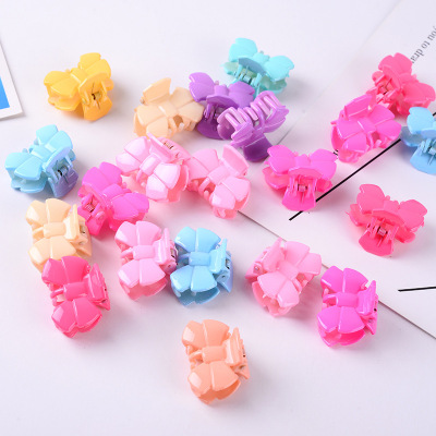 Popular Korean version of a cute candy color children's grasping bowknot plastic hair clip children's headdress manufacturers